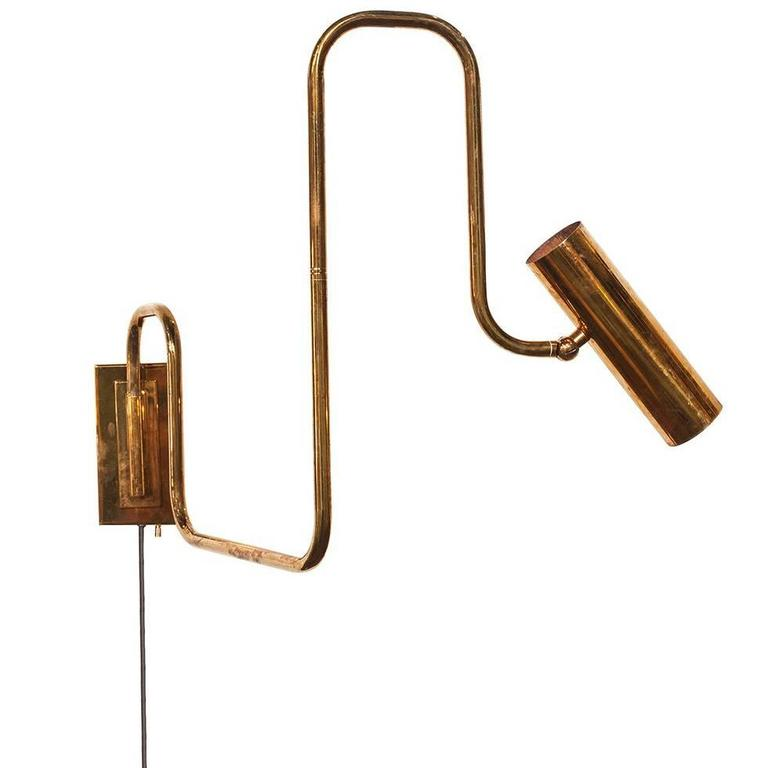 Pivot Single Wall Sconce with Articulating Arms in Brass For Sale