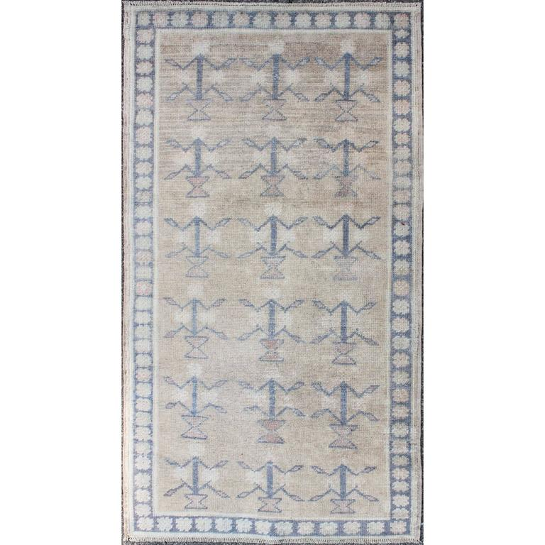 Small Turkish Tulu Carpet with Blue Tribal Motifs in a Sand-Colored Field