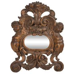 Carved Mirror with Two Angels and Shell Motifs at Top and Bottom