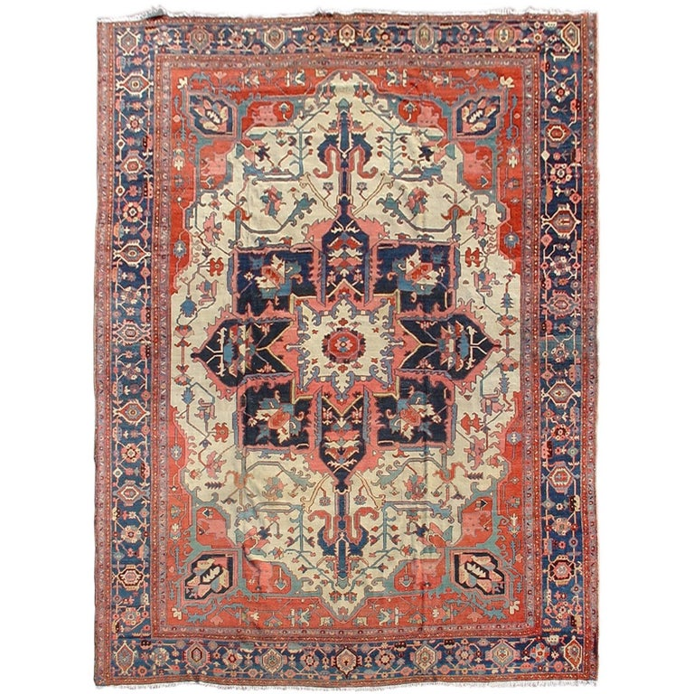 Late 19th Century Red and Blue Serapi Rug with Central Medallion Pattern