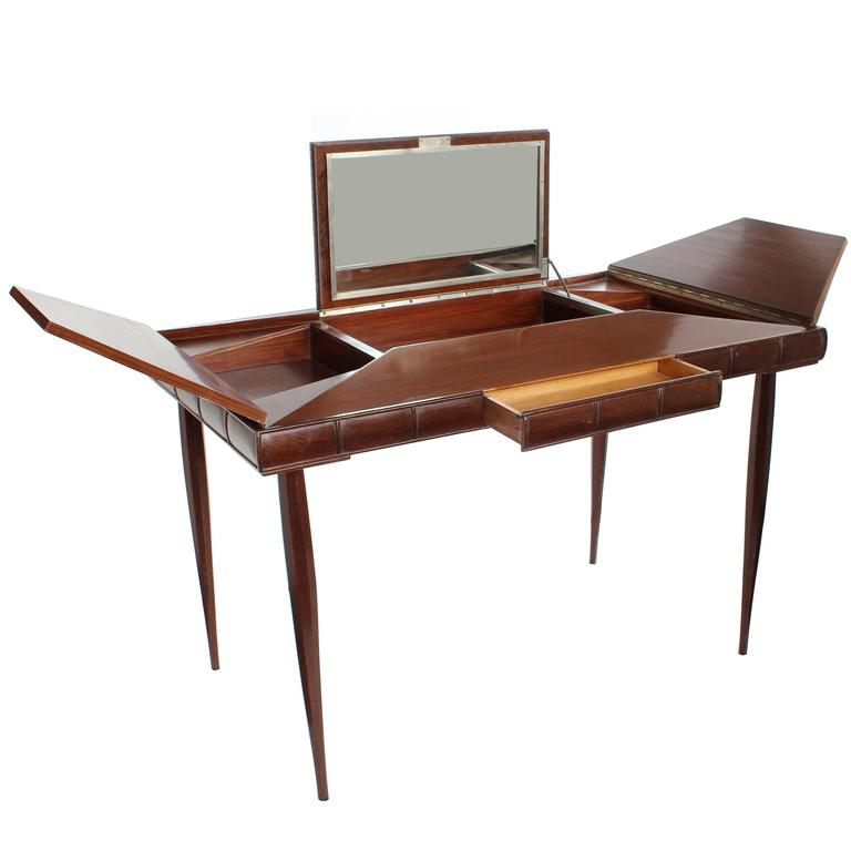 A French art Deco palissandre (rosewood) and palm wood envelope-style vanity with center fold up mirror, drawer and two-fold up side compartments, circa 1940.  Architect, Sandy Littman of Duesenberg LTD.  and The American Glass Light Company have
