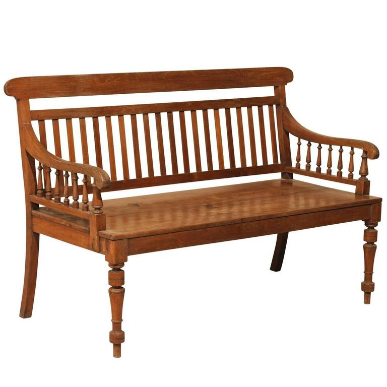 British Colonial Style Teak Wood Bench With Slats On The Backrest Turned Legs For