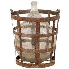 Mid-Century French Patinated Vintner Iron Basket with Demijohn Wine Bottle