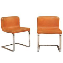 Two French Mid-Century Modern Leather and Chrome Accent Chairs