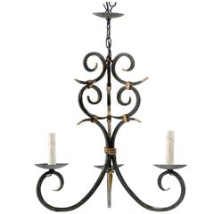 French Forged Iron Three-Light Chandelier with Scrolled Arms and Gilded Accents