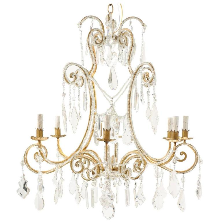 Italian Eight-Light Crystal and Gilded Iron Chandelier with Ornate Scrolls