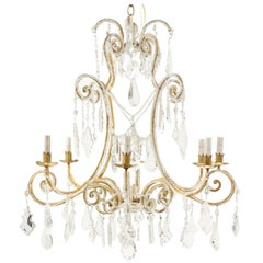 Italian Eight-Light Crystal and Gilded Iron Chandelier with Ornate Scroll Design