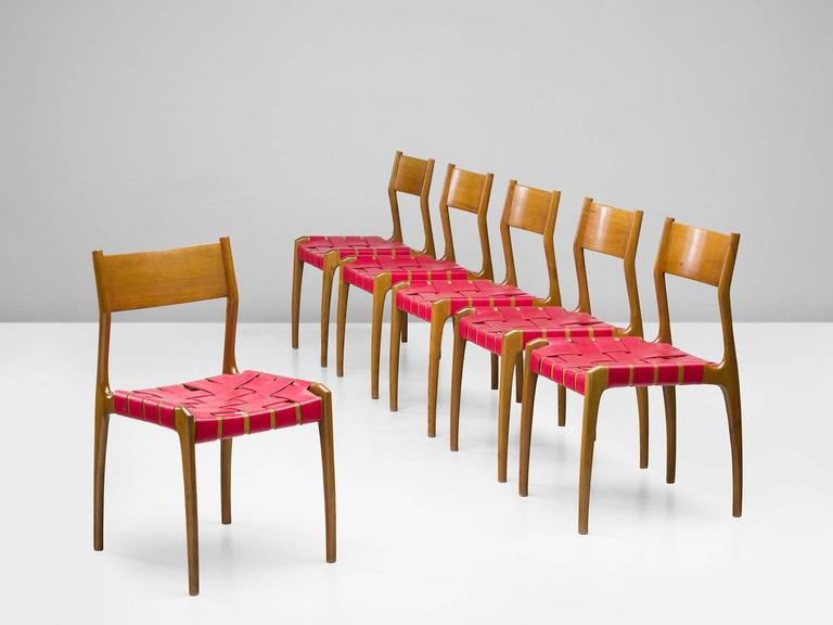 Set of six chairs, canvas and beach, Italy, 1950s.  This set of six chairs has a canvas webbing as its seat. The frame itself is executed in solid beech. Although these chairs appear to be straight and and minimalistic, the frame shows some organic,