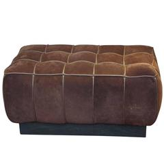 1990s Warm Brown Suede Leather Ottoman with a Wooden Base and a Leather Handle