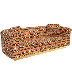 Rounded Barrel Back Brass Platform Sofa Reupholstered in African Mud Cloth