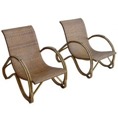 Pair of Mid-Century Monumental Woven Armchairs in Rattan