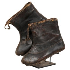 Pair of Vintage Leather Tribal Chinese Winter Boots on Custom Iron Stand