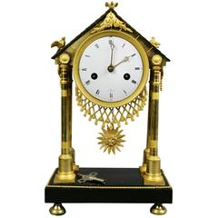 Charles X Ormolu and Patinated Bronze Mantle Clock