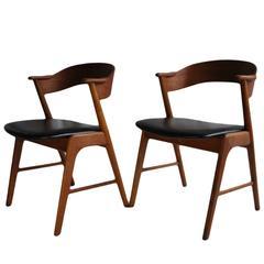 Pair of Kai Kristiansen model 32 chairs, new leather.