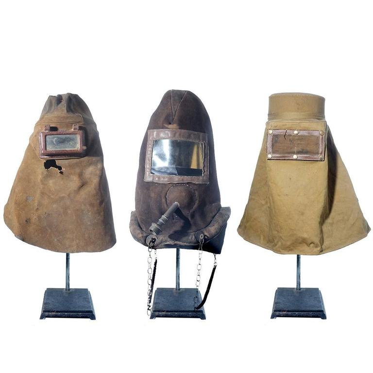 Three Early Industrial Masks For Sale