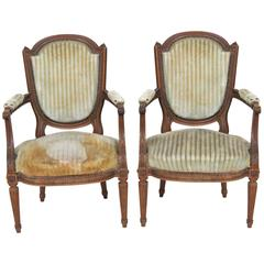 Pair of Antique Louis XVI Style Carved Walnut Fauteuils