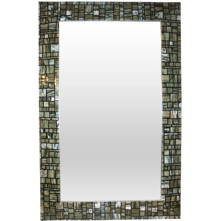 Contemporary Italian Murano glass mirror, exclusive Venetian work of art for Cosulich interiors by Veve Glass, skillfully and masterly realized as an abstract earth tones mosaic with the FUSION technique, each individually handcrafted geometric
