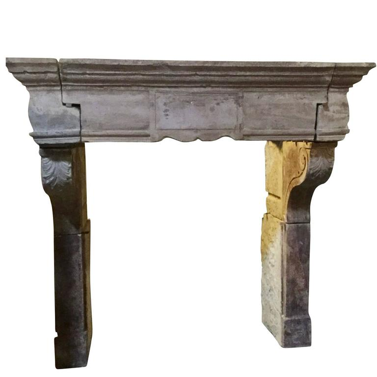 For Sale on 1stdibs - This is a very special one of a kind original fireplace surround in limestone with remains of the original patina. The sizes