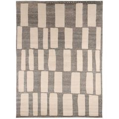 Contemporary Grey and White Wool 'Coco Drum' Area Rug