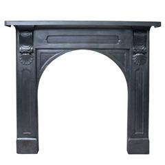 Antique Mid-Victorian Cast Iron Fireplace with Arched Aperture