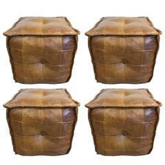 Four Vintage Tufted Leather Ottomans