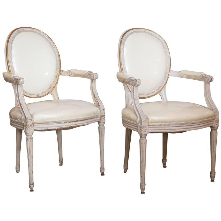 Pair of 19th Century White and Gilt Oval Back Louis XVI-Style Armchairs