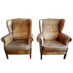 Pair of Early 20th Century Brown Leather Wingback Armchairs