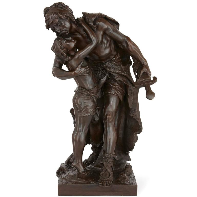 Antique patinated bronze sculpture of a father and son embracing by Henri Plé