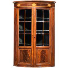 George III Period Mahogany Bowfront Corner Cupboard with Inlay Oval Patera