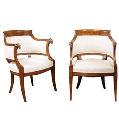 Pair of Austrian 1840 Biedermeier Barrel Back Armchairs with Carved Ram's Heads