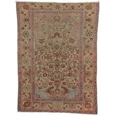 Antique Turkish Hereke Rug in Soft Pastel Colors