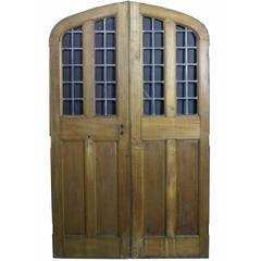 Pair of Arched Oak Double Doors with Leaded Glass Panel, circa 1900