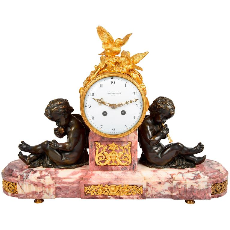 Louis XVI Style Mantel Clock with Doves and Putti Playing Pipes