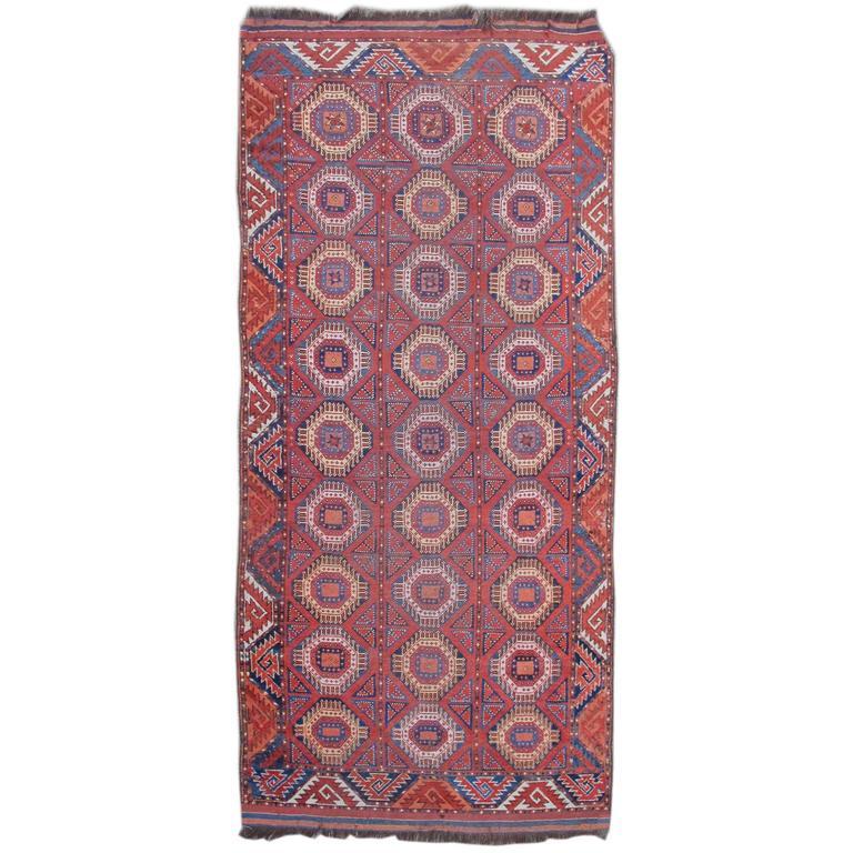 19th Century Red Bashir Ersari Carpet with Tiled Octagons