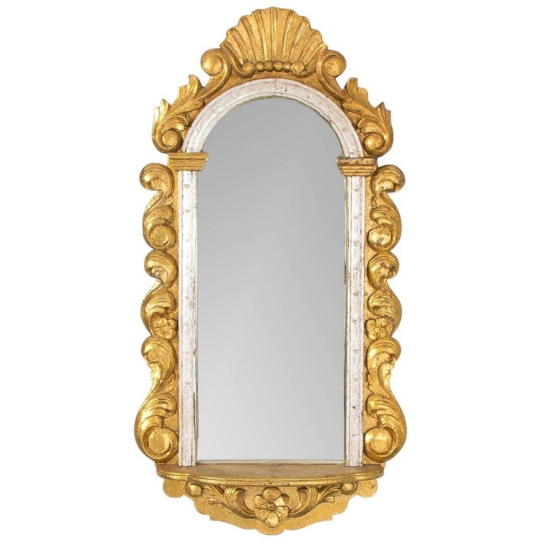 Baroque style carved gilded wall mirror for sale at 1stdibs for Gilded baroque mirror