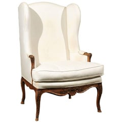 French Louis XV Style Early 19th Century Wingback Chair with Scalloped Skirt