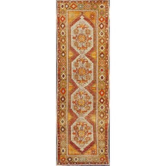 Colorful Antique Oushak Runner with Four Medallions in Yellow, Red, Green, Gray