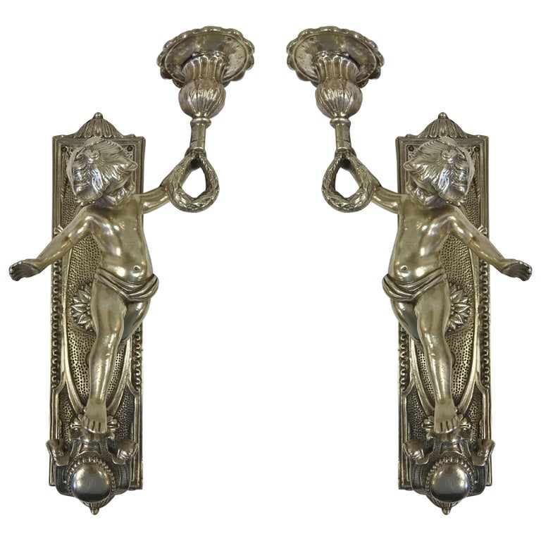 Pair of Bronze Cherub Sconces For Sale
