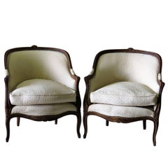 Pair of Louis XV Style Walnut Carved Bergeres