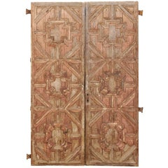 Pair of Spanish Wood Carved Doors with Carved Pattern and Warm Coloring