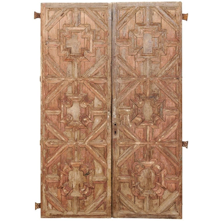 Pair of spanish wood carved doors with pattern and