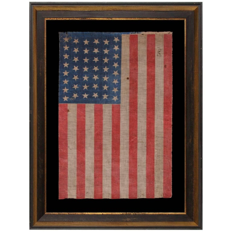 44 Stars in Dancing Rows in an Hourglass Formation, on an Antique American Flag