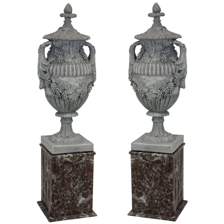 Pair of Large Plaster Urns on Marble Plinths 1