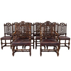 Rare Set of Thirteen Carved Oak Black Forest Dining Chairs