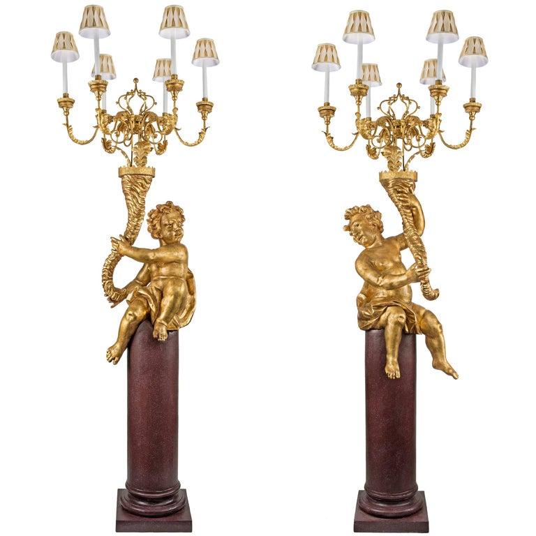 Pair of Italian 17th Century Giltwood  Six Arm Cherub Candelabra Torchières
