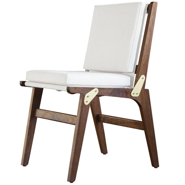 Ofs dining chair with white canvas upholstery and coach for Coach furniture