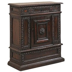 Early 18th Century Italian Small Cabinet with Rich Dark Finish and Carvings