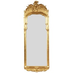 18th Century Continental Rococo Carved and Gilt Mirror Having Segmented Glass