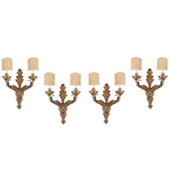 Set of Four Gilt Iron Two-Light Wall Sconces
