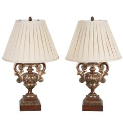 Pair of Italian Silvered and Gilt Carved Urns Mounted as Lamps